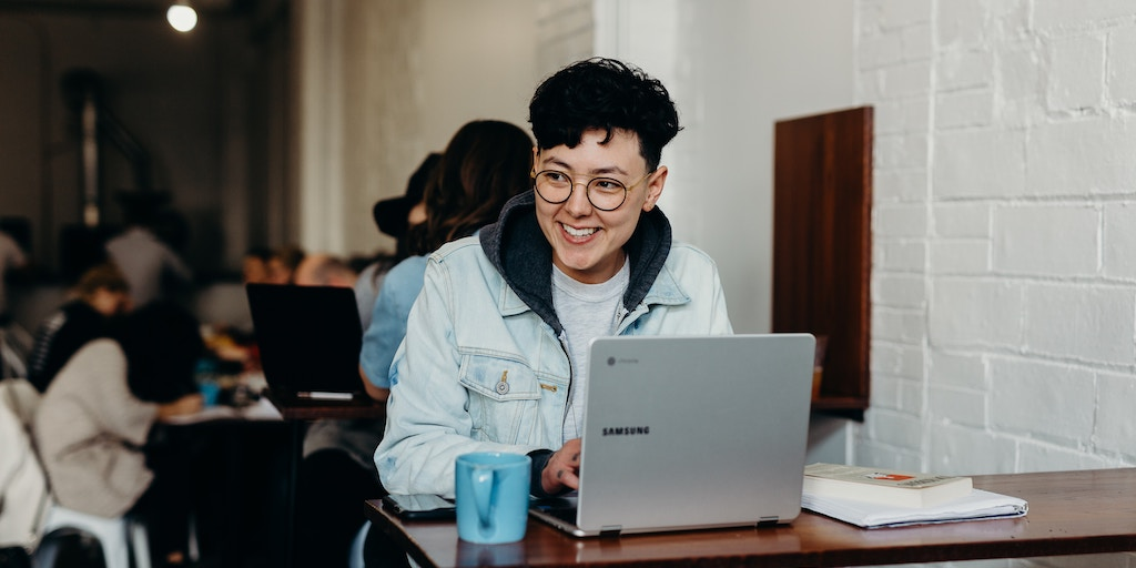 happy person at laptop